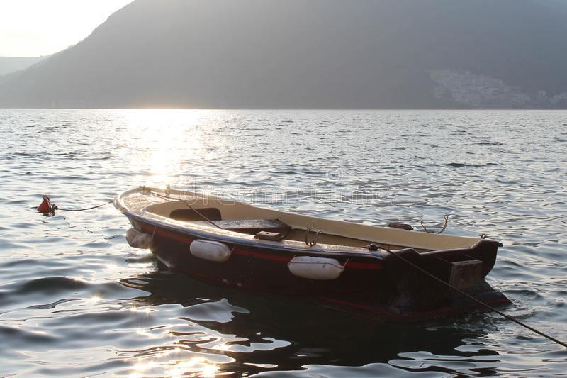 Cute Boat in the Boka Bay. Cute Boat on the waves in the Boka Bay near Perast. Montengro stock photography