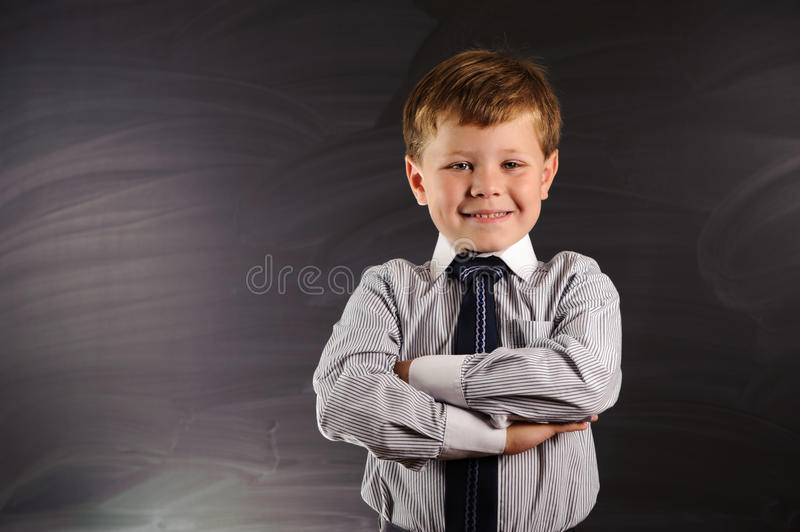 Download Cute Boy Against Blackboard Royalty Free Stock Photos - Image: 26545138