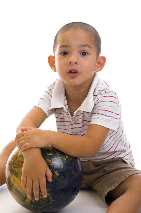Cute boy with bowling ball stock photography