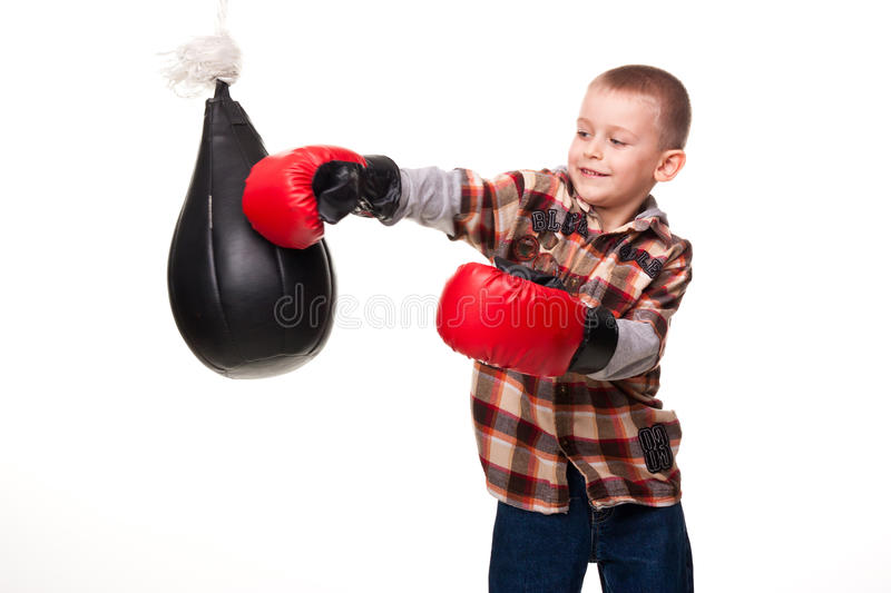 Cute boy in the boxing gloves. Isolated on white stock photography