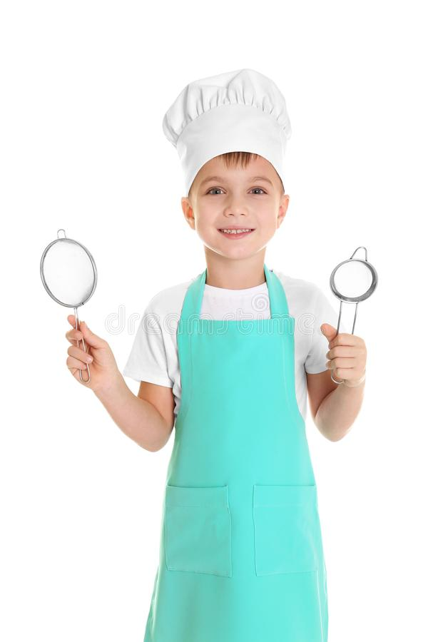 Cute boy in chef hat with sieves, isolated. On white royalty free stock images
