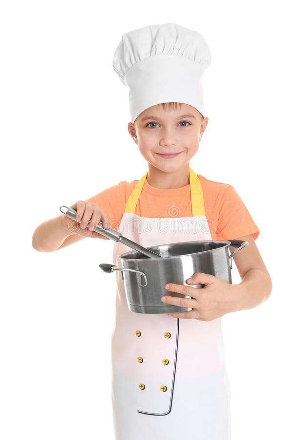 Cute boy in chef uniform with stewpan and ladle, isolated royalty free stock image