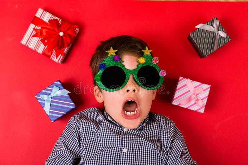 Cute boy with Christmas presents royalty free stock photos