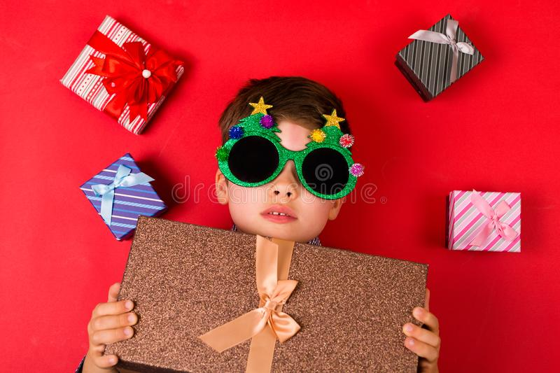 Cute boy with Christmas presents royalty free stock photography