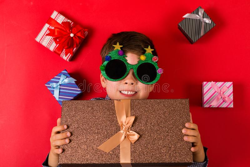 Cute boy with Christmas presents royalty free stock images