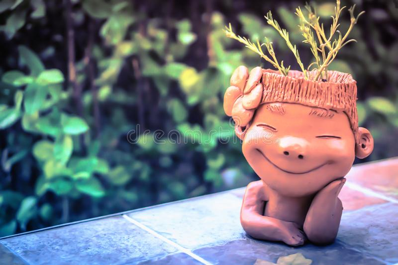 Boy clay doll smile decorate in the garden. Cute boy clay doll smile decorate in the garden royalty free stock photography