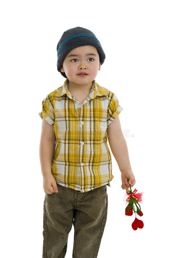 Cute boy with flower and heart gift royalty free stock photo