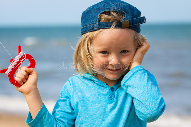 Cute boy flying kite royalty free stock photography