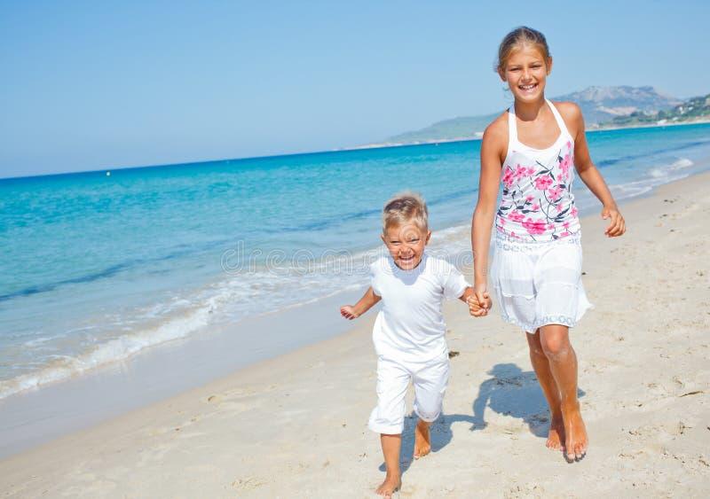 Cute boy and girl on the beach
