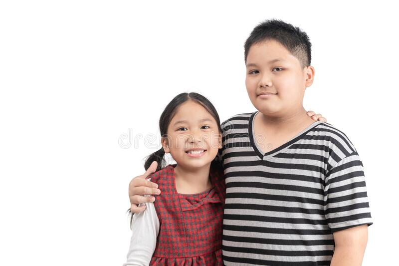 Cute boy and girl hugging playing on white background royalty free stock photo