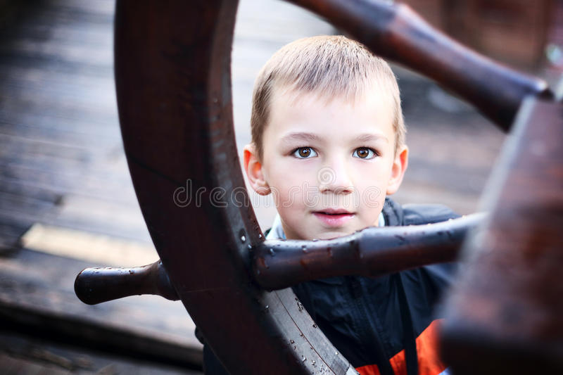 Download Cute Boy Hides Behind The Wheel Stock Photo - Image: 30455112