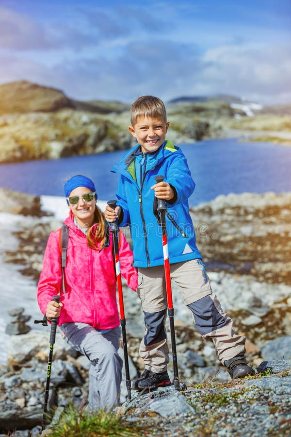 Boy hiker with his sister at the norwegian mountains stock photography