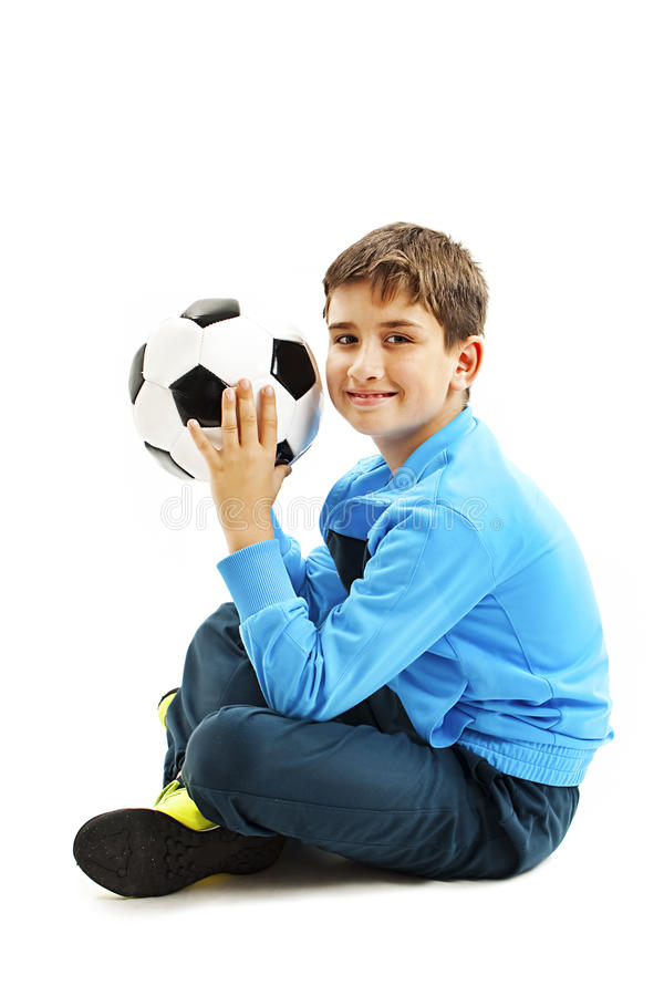 Cute boy is holding a football ball made of genuine leather royalty free stock photo