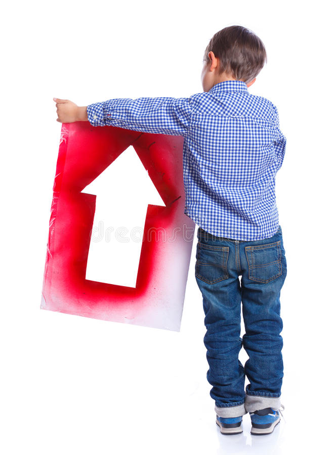 Cute boy holding red arrow stock image