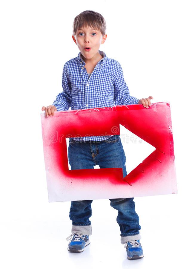 Cute boy holding red arrow. Isolated on white background stock photography