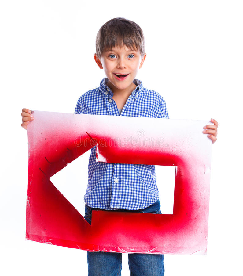 Cute boy holding red arrow. Portrait of cute boy holding red arrow. Isolated on white background stock photography