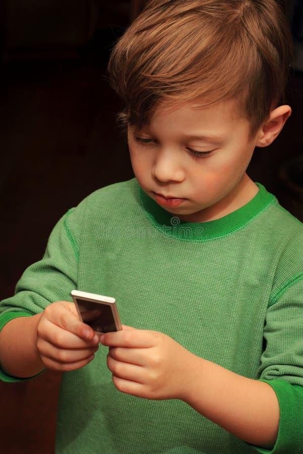 Cute Boy with iPod stock photos
