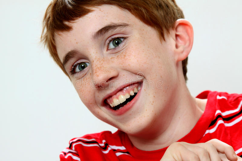Cute boy laughing and leaning stock image