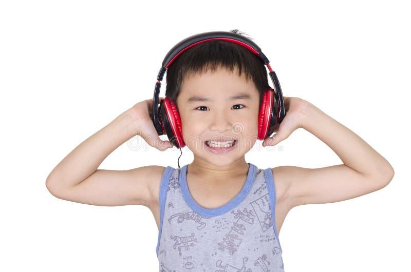 Cute boy listen to music stock photo