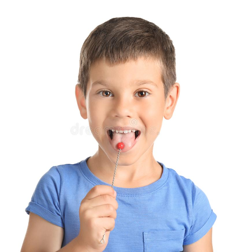 Cute boy with logopedic probe for speech correction on white background royalty free stock image