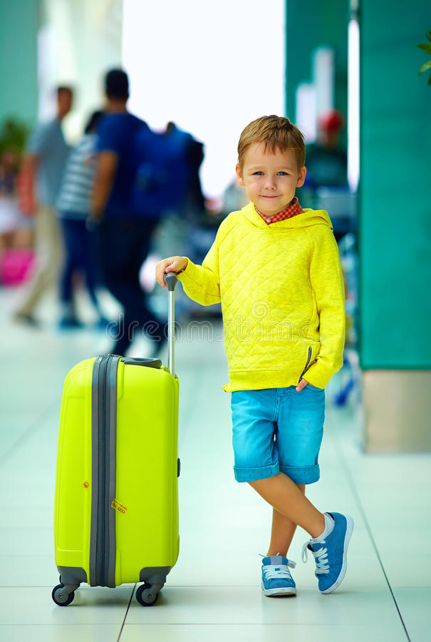 Cute boy with luggage in airport, ready for summer holidays. Cute boy with luggage bag in airport, ready for summer holidays royalty free stock photography