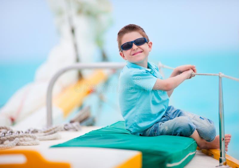 Cute boy on luxury yacht