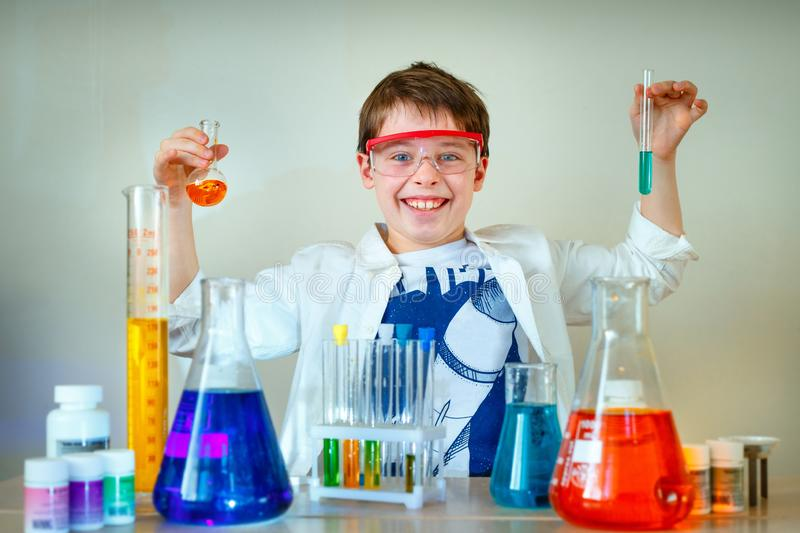 Cute boy is making science experiments in a laboratory. Education stock image