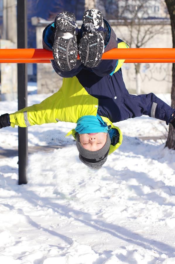 Cute boy play outdoors in snow. Happy boysl playing on a winter walk in nature royalty free stock images