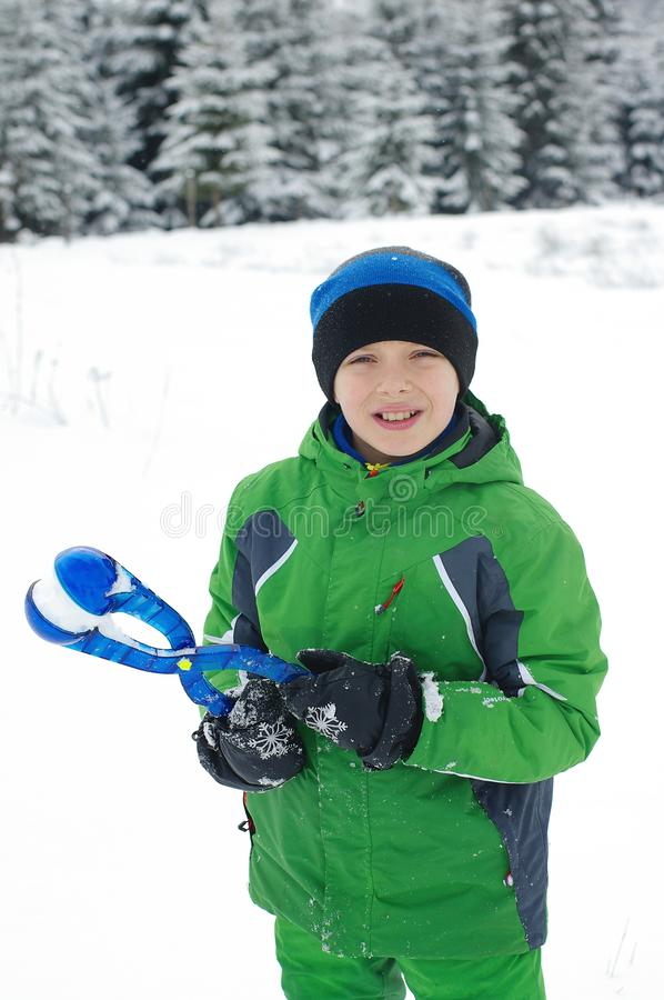 Cute boy play outdoors in snow. Happy boysl playing on a winter walk in nature stock image