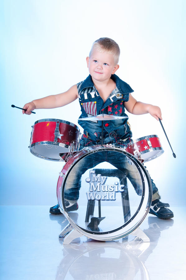 Download Cute boy playing the drums stock photo. Image of small - 29029964