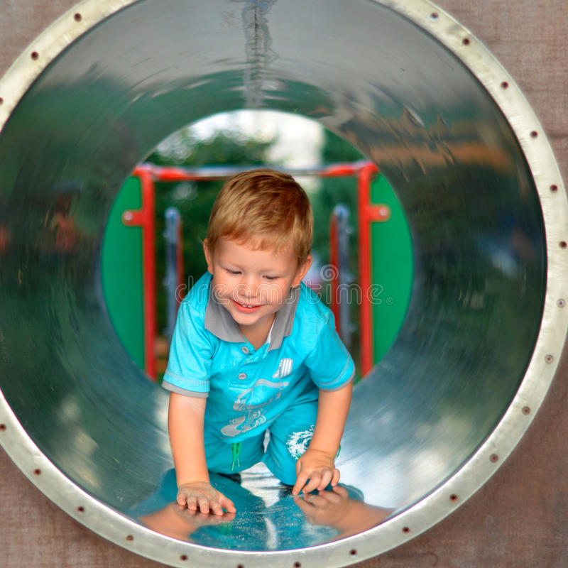 Cute boy playing in the playground royalty free stock photos