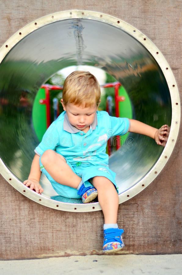 Cute boy playing in the playground royalty free stock images
