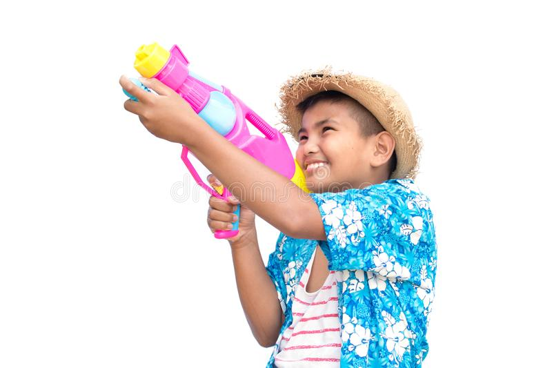 Cute boy playing water gun on white background royalty free stock image