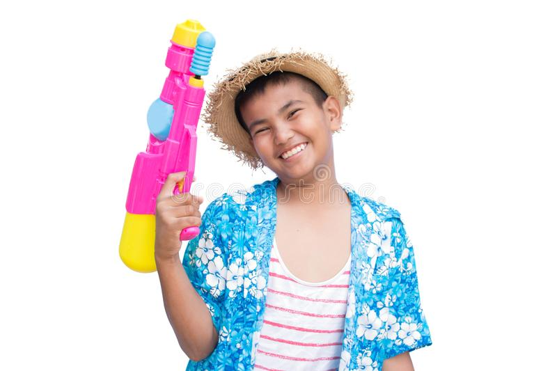 Cute boy playing water gun on white background royalty free stock photo