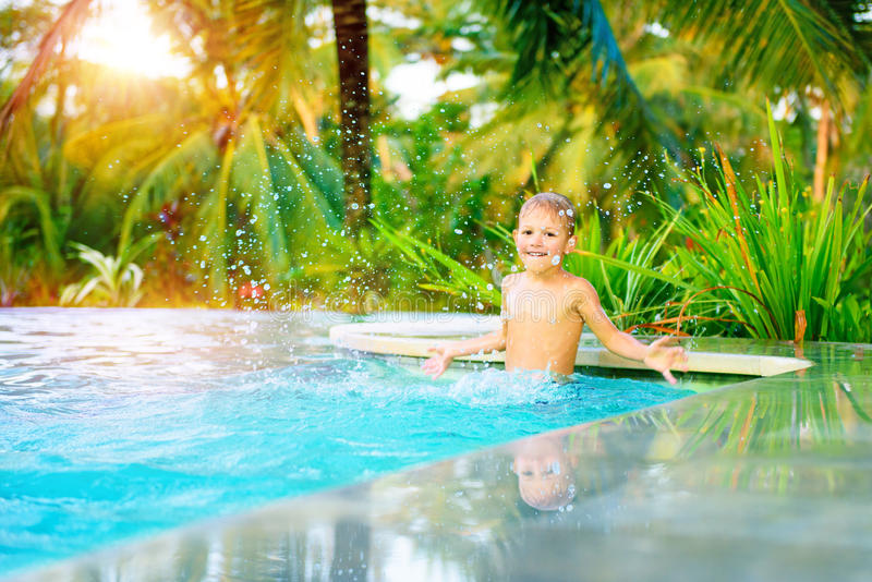 Cute boy in the pool stock images