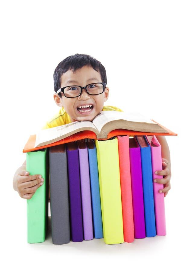Cute boy reading book royalty free stock photos