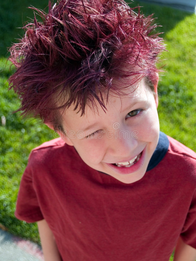 Cute boy with red hair royalty free stock image