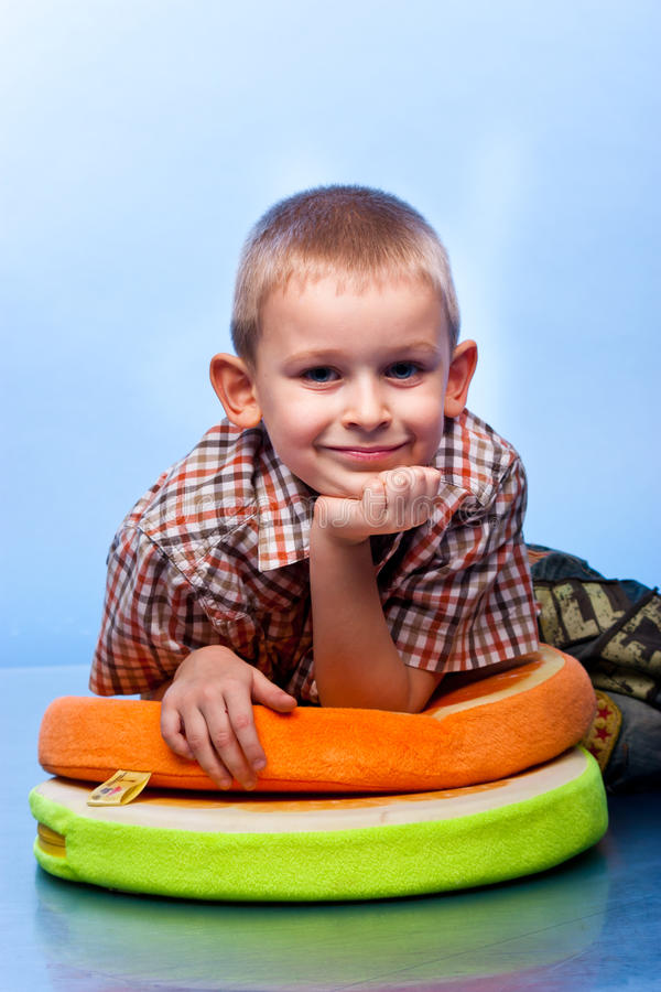 Free Cute Boy Resting On A Pillow Stock Photo - 19515990