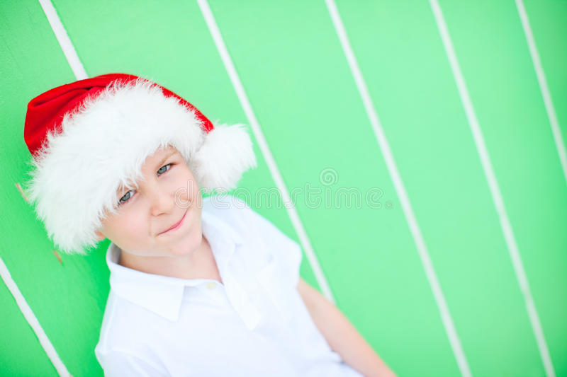 Download Cute boy in a Santa hat stock photo. Image of expression - 26675994