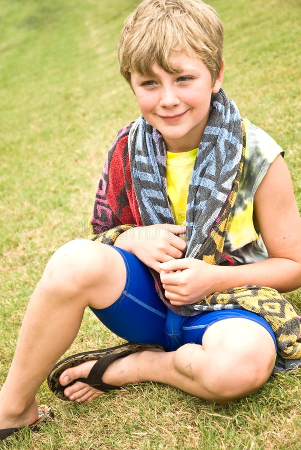 Download Cute Boy Sitting in Grass stock image. Image of expression - 9681899