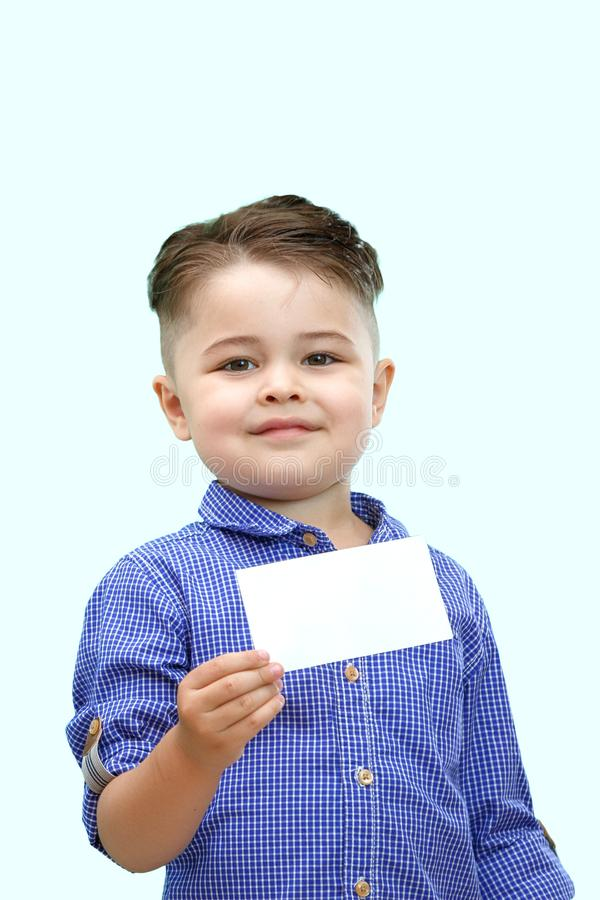 Cute boy standing with empty blank in hands, isolated on white royalty free stock photos