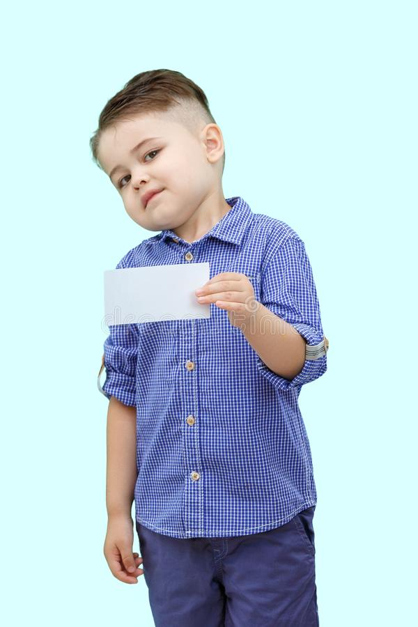 Cute boy standing with empty blank in hands, isolated on white royalty free stock image