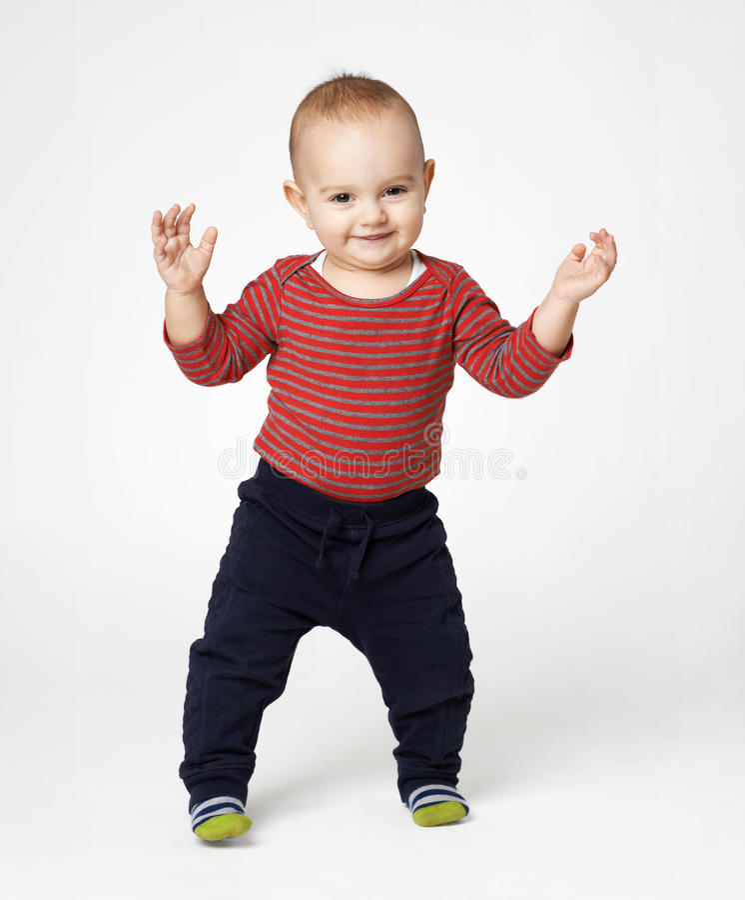 Cute boy standing ovation. Cute little boy standing ovation royalty free stock photography