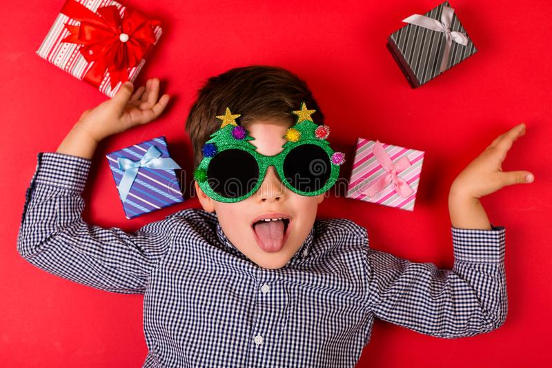 Cute boy with Christmas presents stock photo
