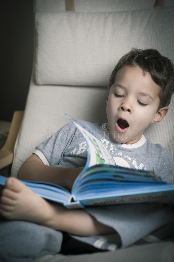 Download Cute boy tired stock image. Image of books, sitting, children - 28563849