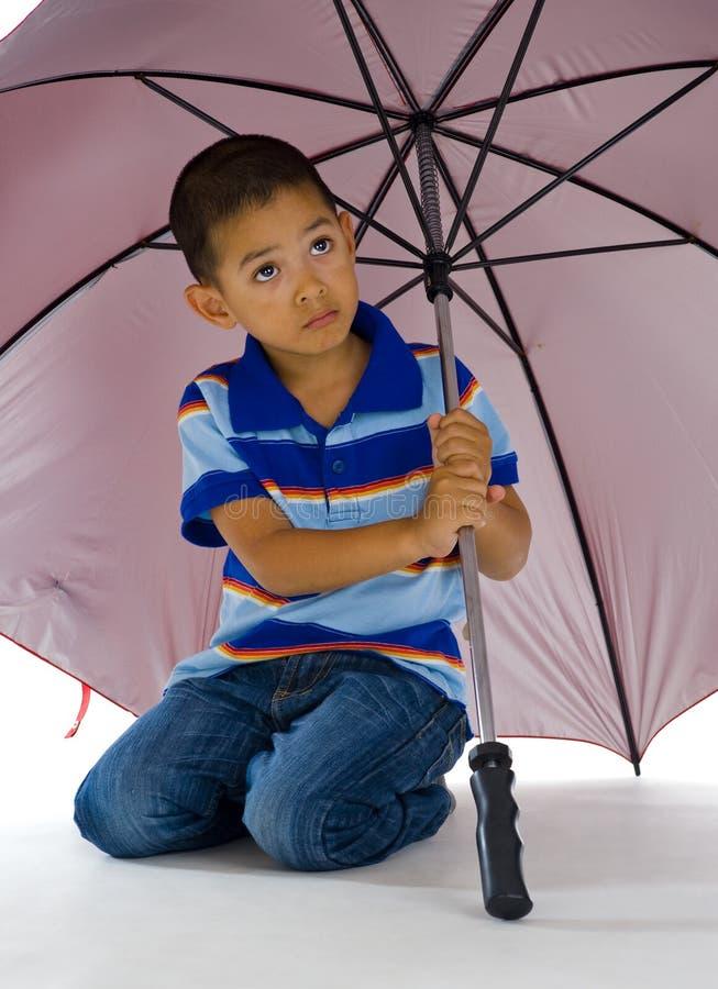 Cute boy under huge umbrella royalty free stock image