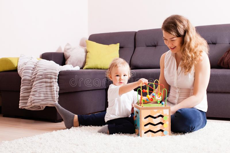 Cute boy wants to play on the carpet royalty free stock image