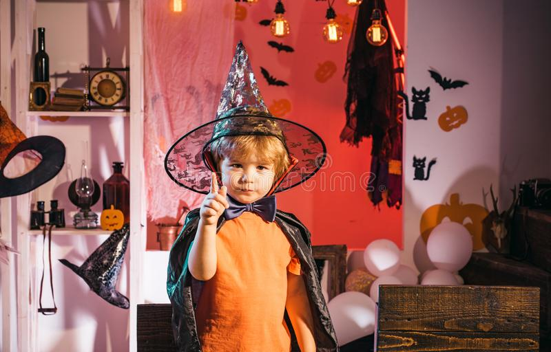 Cute boy in a wizard costume. Happy Halloween. Costume for a party. Childrens October. Fun party. Cute boy in a wizard costume. Happy Halloween. Costume for a royalty free stock image