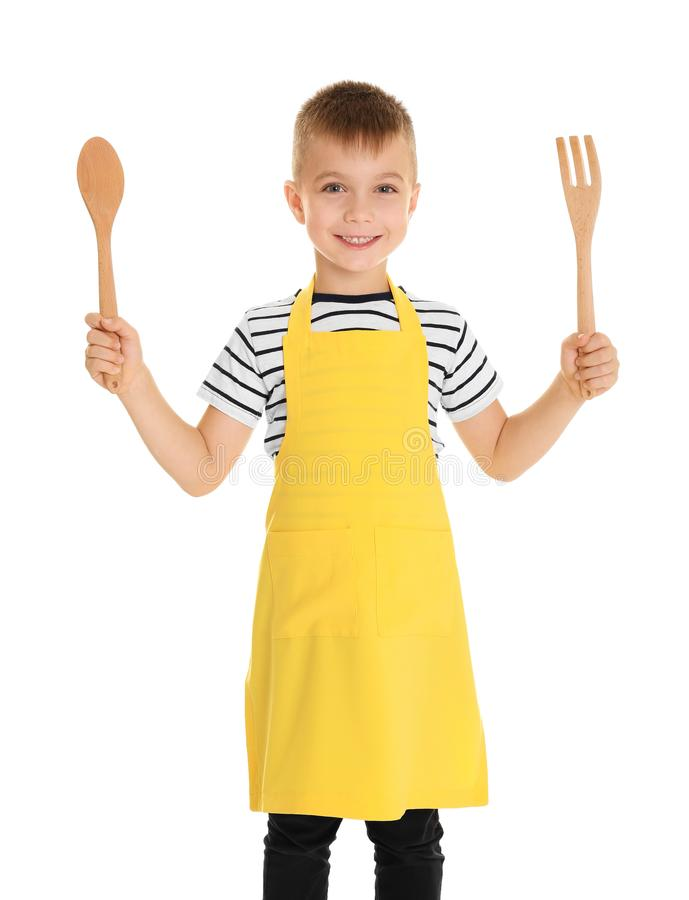 Cute boy with wooden spoon and fork, isolated. On white royalty free stock photo