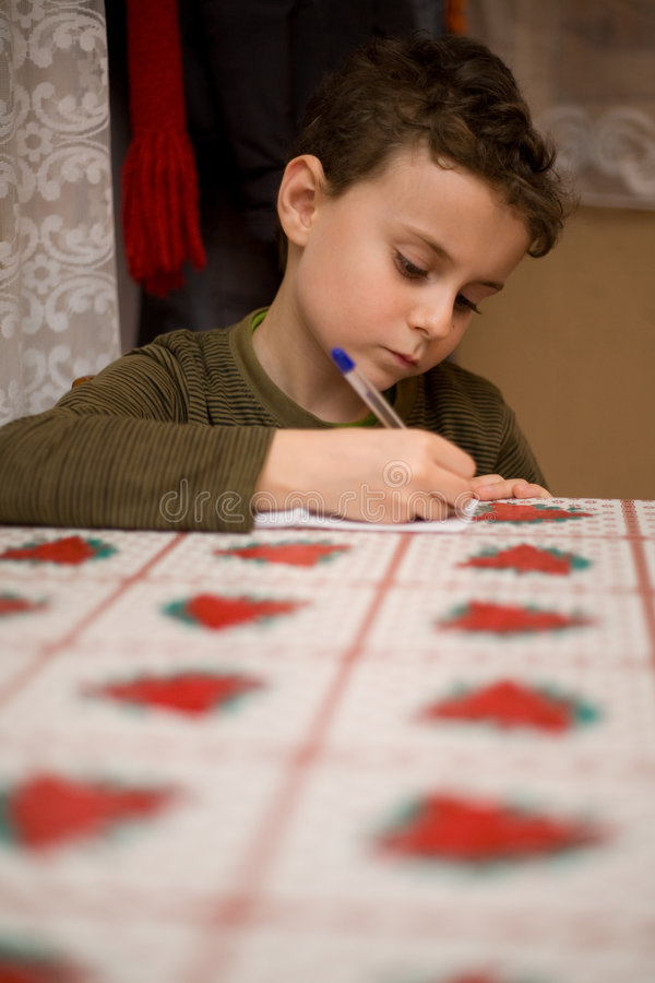Download Cute Boy Writing In A Notebook Stock Image - Image: 8757553